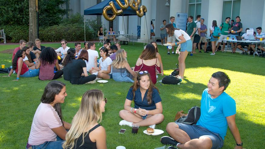 Students socialize on the green